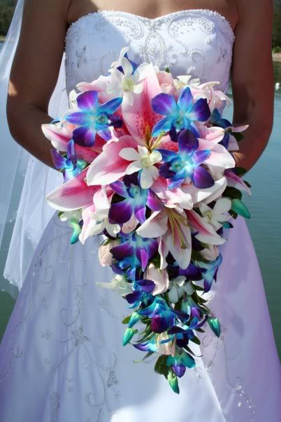 Beautiful cascading bridal bouquet made of Pink Oriental Lillies