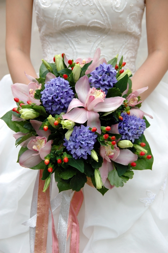 Pastel pink lilies with purple and green flowers