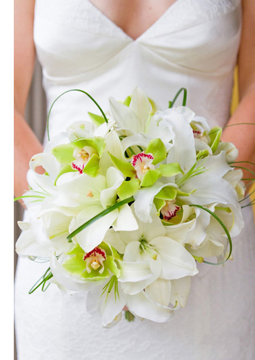 Amazing bridal bouquet made of white lilies green orchids and bear grass