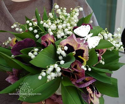 lily of the valley and pansy bouquet