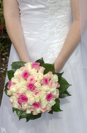 white roses with a few pink roses bouquet