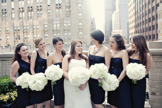 bridesmaids with white peonies bouquet