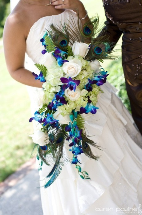 Beautiful bouquet with Peacock Feathers and blue and purple orchids