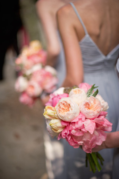 Stunning bride and bridesmaids bouquets featuring peach pink and white