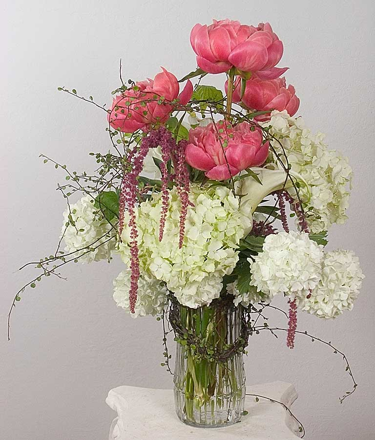 Coral pink peony bou­quet with white hydrangea and Angel Ivy