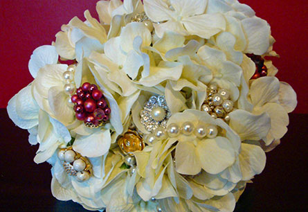 Silk hydrangea flowers and vintage jewelry bouquet