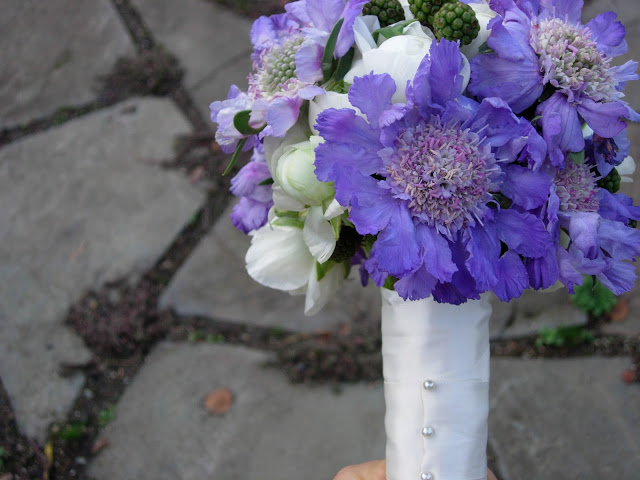 bouquet of lavender-colored scabiosas, white ranunculus, and blackberrie 1