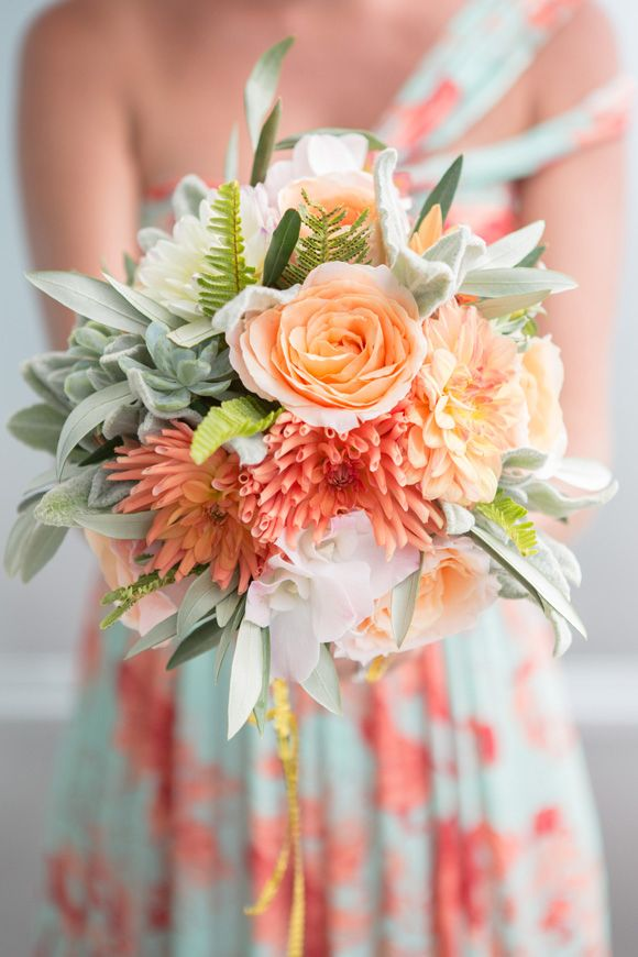 coral, peach and succulent bouquet color combination with the bridesmaid's dres