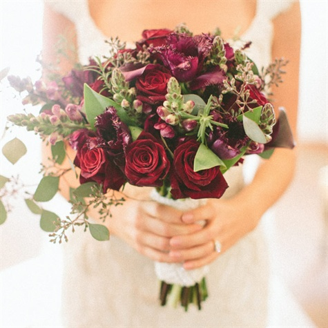 deep red bouquet of roses and parrot tulips