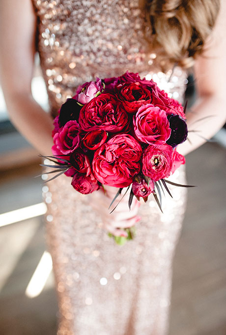 Bridal bouquet of garden roses, peonies, and anemones with black accents