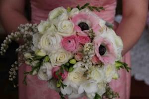 Bridesmaid's bouquet of roses, ranunculus, anemones, freesias and pierus
