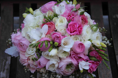Bridal bouquet of ranunculus, freesias and roses