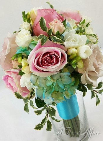Pink and white bouquet with a touch of blue
