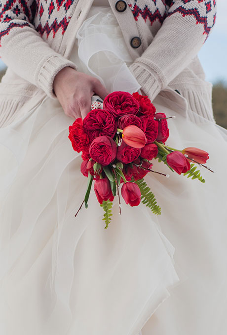 Red bouquet of garden roses and tulips