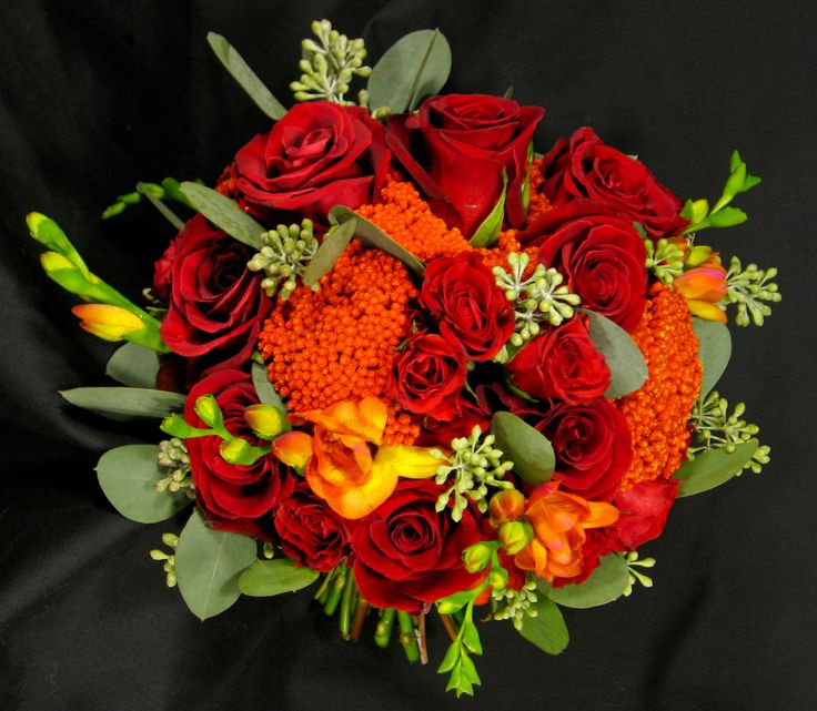 Red rose, orange freesia and orange yarrow bouquet