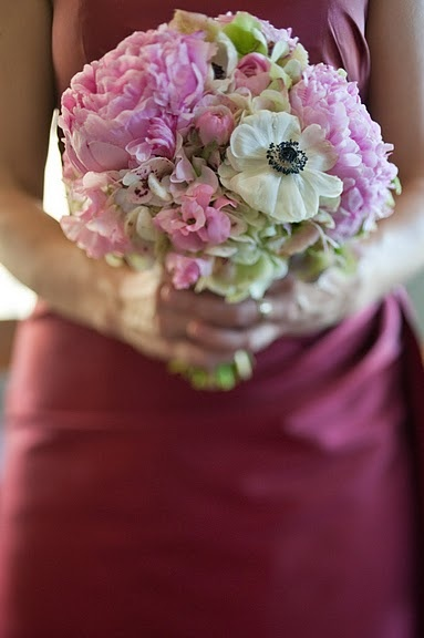 Springtime bridesmaids bouquet with anemones and peonies