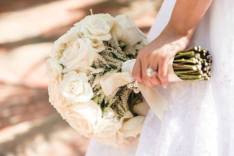 Traditional white roses wedding bouquet