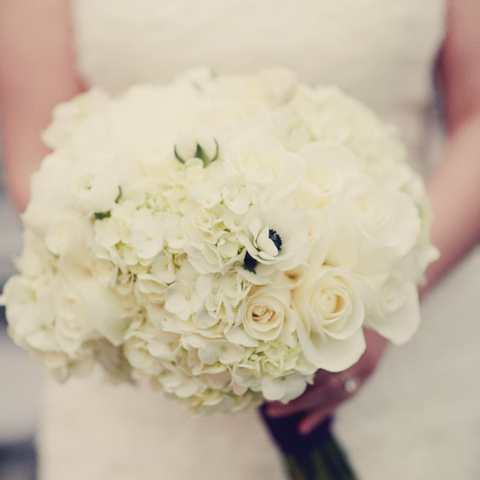 white bridal bouquet of peonies roses hydrangeas ranunculus and anemonies
