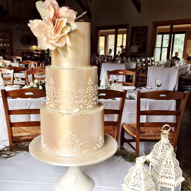 Gold with white swirls wedding cake