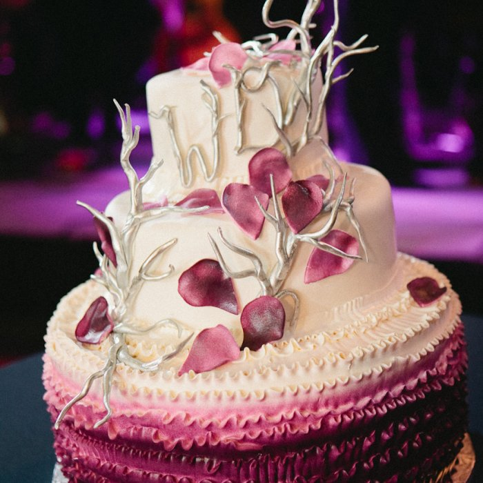Purple ruffled ombre wedding cake