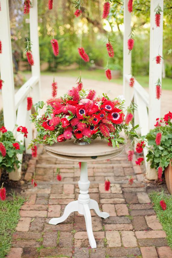 red wedding flwoers anemones and bottle brish