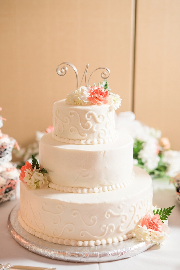 Circular three tier wedding cake in white with white frosted swirls