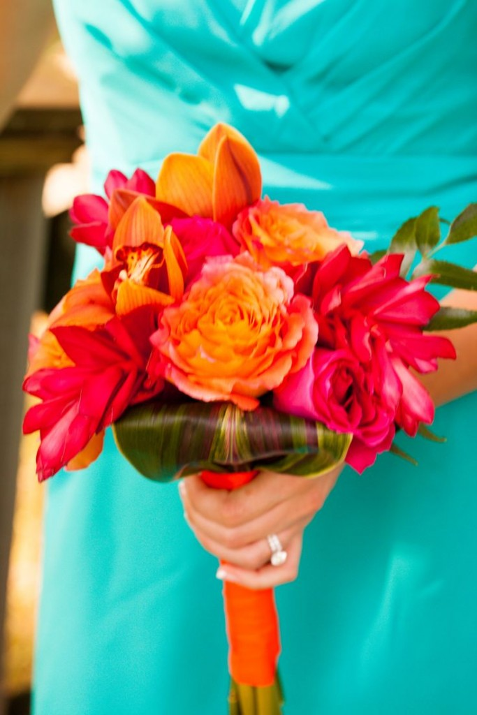 Bouquet made of orange chile roses, kiko fuschia roses, red ginger, cymbidium orchids