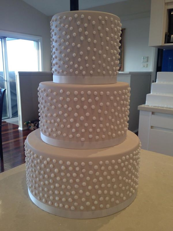 white dotty wedding cake