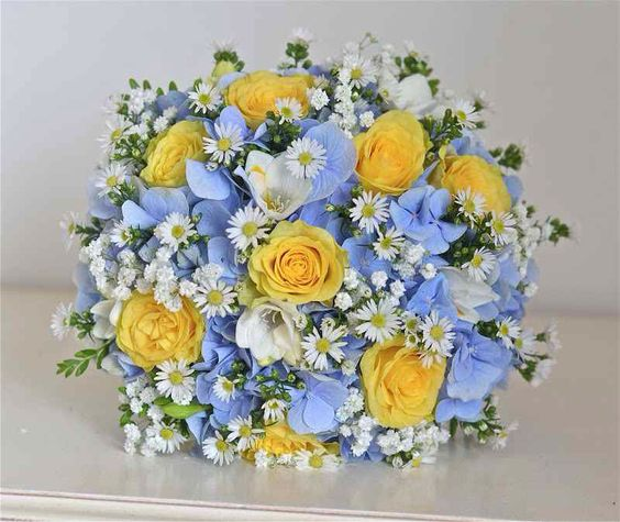Blue hydrangeas and yellow roses