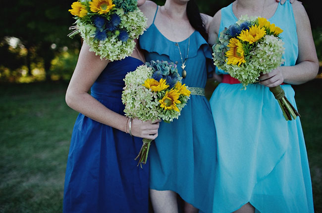 Bridesmaids bouquet of blue hydrangeas and sunflwoers