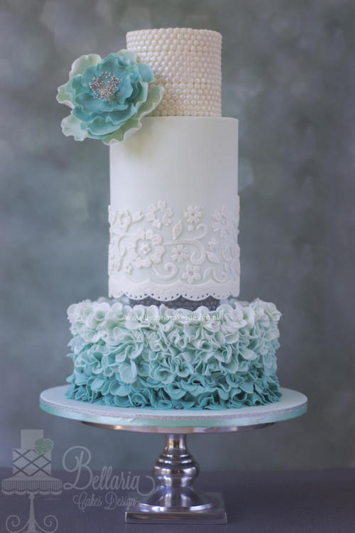 Ombre ruffle and pearl wedding cake