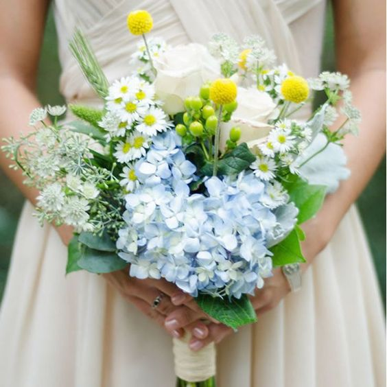 blue hydrangeas, white roses and billy balls